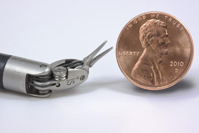 instrument_tip_size_comparison_with_US_penny_72
